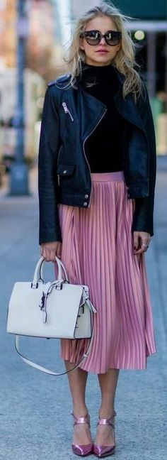 Black biker jacket, Black turtleneck, Satin pink pleated midi skirt, White Saint-Laurent handbag, Metallic pink ankle strap pumps | NYFW Winter Street Style | Carodaur #black