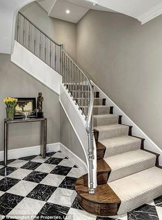 A chrome staircase leads to the upstairs.