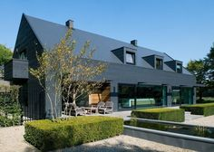 WillemsenU Architecten has remodelled a house near Eindhoven, adding a new dark cladding to the exterior and reorganising the rooms inside Residential Architecture, Contemporary Architecture, Architecture Design, Contemporary Homes, Modern Barn, Modern Farmhouse, 1960s House Renovation, Timber Cladding, Black Cladding