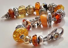 Amber Dreams by a Trollbeads Gallery Forum member- looking for more glittery ambers and a square dark amber like on this bracelet