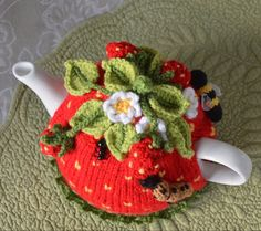 Quick & easy to make this 4-6-cup Tea Pot Cosy, called Strawberry Field Tea Cosy Pattern  Not only make it for yourself, but what a lovely birthday or special gift to someone, especially if they have everything or you have run out of idea what to give!  Basic Skills Needed: Knitted on the flat with single pointed needles American terminology with metric measurements Basic knitting stitches are used Basic crochet are used for the leaves, stems, flowers & doily  As with all my patterns, as a…