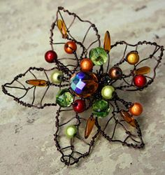 I want to learn to make this!!    ♥ Autumn wire leaf beaded brooch