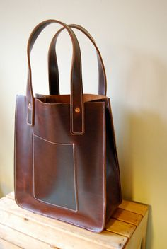 Handmade by a former graphic designer in California, probably the last brown leather bag I will ever need to buy.... JAW Leather Goods handmade tote bag in dark brown