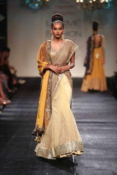 Sari. Indian Fashion. Indian couture. South Asian Fashion. Yellow and gold. Lakme Fashion Week Winter Festive 2014     Designer: Vikram Phadnis