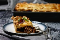 This home made Cape Malay Pepper Steak Pie is flavorful tender steak cubes in a rich onion and mushroom gravy between layers of buttery flaky pastry.