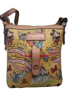 Our Dooney & Bourke Sketch Crossbody Bag features a whimsical print of some of your favorite Disney characters from Mickey to Tinker Bell and more! Lots of handy pockets, an adjustable strap plus famous designer styling make it an instant favorite. This is our last one!!