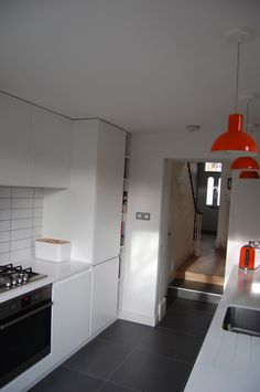 White handleless kitchen with corian worktop