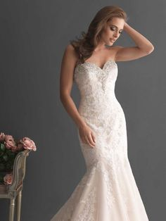 This Allure Bridal wedding dress is a show stopper in person. The beading on the top is complimented by sequence in the dress and is a total wow. We have her to try on at Marry & Tux located in Nashua, NH.