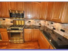 Kitchen Backsplash With Oak Cabinets honey oak kitchen cabinets with black countertops |  pearl or