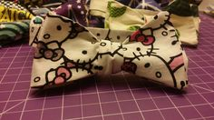 Available in both child and adult sizing! Hello Kitty Bow, Bow Ties, Dinosaur Stuffed Animal, Bows, Children, Handmade, Animals, Shopping, Infants