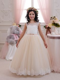 Gorgeous ivory and beige flower girl dress with multilayered skirt, lace corset with applique and rhinestones, and satin stripe.  Item material:
