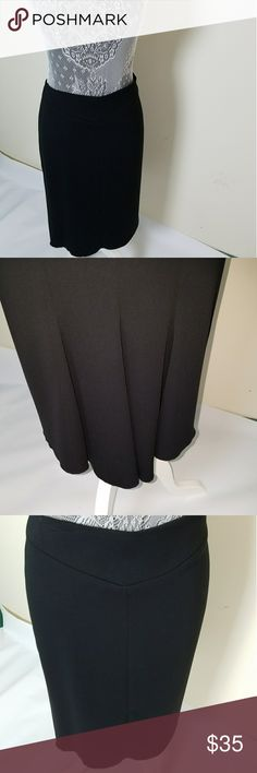 """NWT■BCBG Black Skirt Calling this my """"Im So Fancy"""" black skirt because of the neat detail on back. Front is smooth, no details but back is slightly tapered and flared with a few big pleats. This is new with tags. Lined. Dry clean. BCBGMaxAzria Skirts Pencil"""