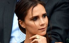 Victoria Beckham's engagement rings:  an elegant emerald-cut diamond on a yellow gold band.
