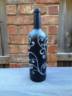 Wedding Table Numbers- chalkboard wine bottles where you can write and change greeting/table numbers/etc to your guest. The back has elabrate rhinestones with a simple front