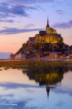 Mont Saint Michel in Normandy, France. You can hear the hoofbeats of knights on horseback echoing | Amazing Places