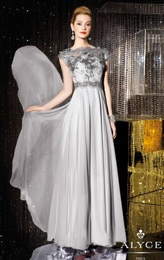 Make a lasting impression in this remarkable Alyce Jean De Lys 29654 creation. This flowing evening gown is made of silky chiffon. The fitted bodice features a sheer scalloped bateau neckline with sheer cap sleeves and a sheer mid v shape back. Beaded appliques adorn the bodice and back to create a stunning finish.