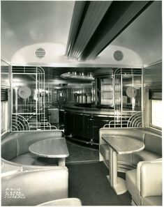 Builder's photo showing the interior around the bar and lounge area of SP's Cascade Club, a triple-unit articulated diner and lounge used on the SP's New Cascade service between San Francisco and Portland. Pullman-Standard built the car in 1949. Unit 10283 contained the kitchen and crew dormitory, 10284 was the middle dining section, and 10285 was the lounge. Carefully concealed articulation between the diner and lounge gave the impression of a single long, continuous room.