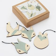 4 delightful laser cut plywood decorations, perfect for your Christmas tree, with hand painted detail, strung on waxed cord, all neatly boxed up ready for action! The set contains: 1x bear, 1x wolf, 1x squirrel and 1x bird.Each decoration measures approx 7cm x 7cm.They are designed by Abigail Brown and hand finished at her London studio.