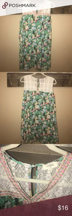Boutique Umgee Dress Sz Medium SZ Medium Classic and beautiful Umgee dress. Pretty vibrant colors and floral are a must have staple for Spring- Summer. Length is 34 inches. Umgee Dresses