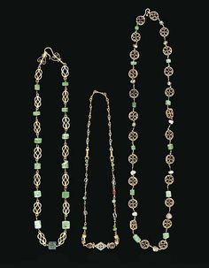 A BYZANTINE GOLD, EMERALD AND PEARL NECKLACE CIRCA 5TH CENTURY A.D. Composed of heart-shaped wire volutes soldered into openwork disk frames, interspersed with links threaded through alternating emerald and pearl beads, with a hook-and-loop closure 24 1/8 in. (61.3 cm.) long