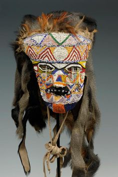 Africa | Beaded mask from the Tabwa people of the Democratic Republic of the Congo | Mid 20th century | Glass beads, fur, monkey hair, cloth, feathers