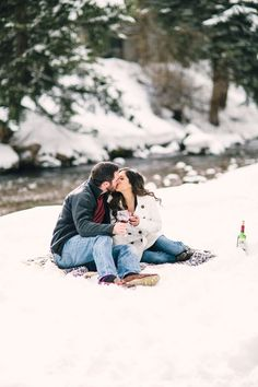 Romantic Winter Engagement Photo ♡   outdoor session   winter photo shoot   engaged   snowy   couple   save the date   Vail   Colorado   wine   picnic in the snow   photography #winterengagement #savethedate by Kelly Lemon Photography