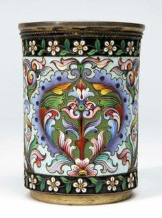 "A Russian silver gilt and cloisonne enamel beaker, MAKER'S MARK ""Mc"", Moscow, DATED 1908 THE SIDES DECORATED WITH POLYCHROME ENAMEL SCROLLS AND FOLIAGE WITHIN A BORDER OF TRAILING FLOWERS"