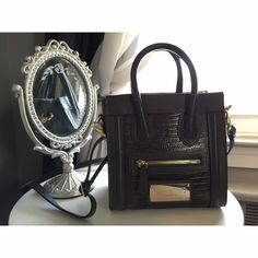 """✨SALE✨Authentic mini Valentino (HP) Authentic mini Valentino tote bag• Genuine leather • snake skin look • has tag and dust bag • measures 9"""" wide 8 1/2"""" tall • zipper to close removable cross body chain • grey • seriously super adorable but too small for me • gorgeous  Valentino Bags Mini Bags"""