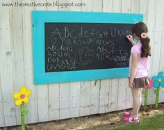 From the Creative Crate Craft Blog. Outdoor chalkboard. Using sanded plywood, chalkboard paint, fencing slats. Inexpensive and keeps the chalk dust outside!