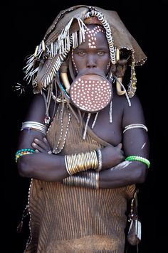 Africa | Mursi woman with huge lip-plate in Omo Valley, Ethiopia | ©John Kenny