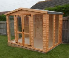 Wooden summerhouse with full length glass included