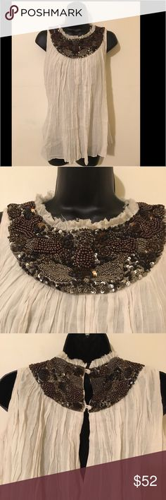 Ecote/Urban Outfitters Heavy Beaded 💯% Cotton Top This top is breathtaking. The beading is high end, top quality just for the weight of the beads and detail. Brand New but no tags, 💯% cotton, never worn. It's an extra small but would easily fit a small/medium. Someone has this posted on eBay for $65 I'm posting it for $52 but will take reasonable offers. If you have any questions let know. Happy shopping 😊 Ecote Tops Tank Tops