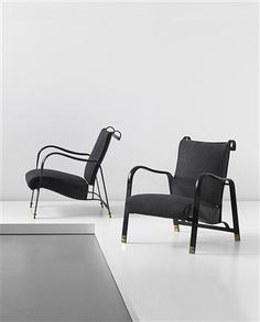 JACQUES ADNET  Pair of armchairs, circa 1960  Leather-covered metal, fabric, brass (2).  Each: 30 3/8 x 25 7/8 x 29 1/2 in (77.3 x 66 x 75 cm)