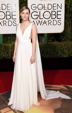 Saoirse Ronan wearing a Grecian-inspired Yves Saint Laurent dress which features a low neck and body cape. This is a great bridal look but would also be lovely in various colours as a bridesmaids dress too. http://www.easyweddings.com.au/blogs/celebrity-weddings/galleries/2016-golden-globes-2016-best-bridal-looks/