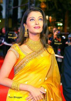 Aishwarya Rai - showing off Gold Jewelry with bright yellow Saree - stunning