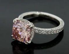 Peachy pink moissanite cushion cut engagement ring
