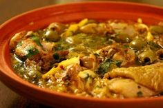 Moroccan Chicken Tagine with Lemon and Olives  ❀   paprika  ❀   cumin  ❀  ginger  ❀  tumeric  ❀  cinnamon  ❀  ground pepper  ❀  olive oil   ❀  chicken thighs and legs  ❀  salt  ❀  garlic  ❀   onion  ❀  peel from 1 preserved lemon  ❀  green olives, pitted  ❀  raisins    ❀  clantro  ❀  parsley