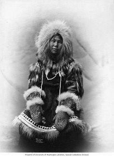 Alaska Eskimo Parka | Cross-eyed Inuit women in fur parka with mittens, Alaska, 1903