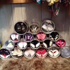 Finally a use for empty formula cans and! A place for all those little shoes!!!!  Whoo hoo!!!