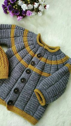 Ravelry: Project Gallery for garter yoke baby cardi pattern by Jennifer HoelCardigan with interesting texture created by the stitch pattern.see what ira grynda iragryndaThis Pin was discovered by MinBaby Knitting Patterns For Kids children jacket Baby Cardigan Knitting Pattern, Knitted Baby Cardigan, Knit Baby Sweaters, Baby Knitting Patterns, Baby Patterns, Knitting Blogs, Knitting For Kids, Free Knitting, Kind Mode