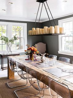 Daniel designed the dining room table out of reclaimed barn beams and slate tile. For dinner parties, Alicia uses chalk to writethe names of guests on the slate in lieu of place cards.