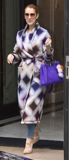 The Power Of Love singer is in the French capital as her European tour continues, and left her hotel last week in a diamond patterned Fendi coat, toting a purple bag featuring the brand's sought after pom pom charms