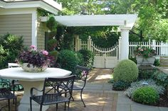 herringbone antique brick & bluestone bands patio design with white pergola. Beautiful landscaping and fencing around the house Outdoor Rooms, Outdoor Living, Outdoor Decor, Beautiful Flowers Garden, Beautiful Gardens, Back Patio, Patio Fence, Fence Gate, Fences