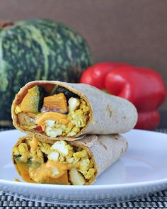 Cheesy Kabocha Breakfast Burrito - a flavorful and filling breakfast handheld that features everyone's favorite winter squash. Ultimate comfort food @spabettie