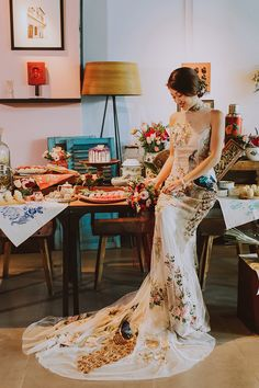 Embroidered peacock cheongsam wedding dress for the Peranakan bride // Our Baba and Nyonya bridal shower styled shoot is as colourful and delightful as the sarong kebayas and desserts it showcases. Planned and styled by Moments at The Tranquerah in Kuala Lumpur, this blend of traditional Peranakan aesthetics and modern styling is sure to inspire you to embrace a history and culture that is uniquely South East Asian.
