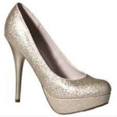 Glitter Pump Heels Really cute gold sparkle pumps Size 6. Only worn a few times. Feel free to message me with questions. Smalls signs of wear on sole of shoe (see image). Mossimo Supply Co Shoes Heels