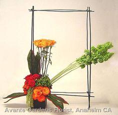 Awesome buffet arrangement featuring roses, hypericum, bells of ireland, amaranthus