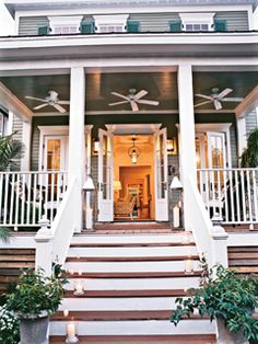 In this New Orleans home, a back wall of doors extends the living area to the porch. The substantial trim work above the doors adds height for a seamless transition to the tall ceilings inside. A raised planter stuffed with fragrant edibles, flanked by a pair of all-weather chairs, is a romantic and easy alternative to window boxes or an extra flower bed.