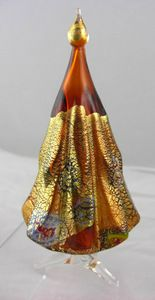 Stunning Murano glass Christmas tree in an amber, jewel tone, transparent glass with Millefiori mosaics and 18kt. gold foil. #authenticitalianglass #muranoglass #muranoitalianglass