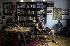 Eylya – artist – drinks and smokes in his house.